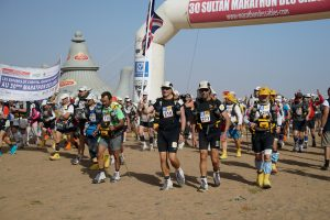 Sir Ranulph Fiennes leaving the start line on the third day of the Marathon des Sables -®LizScarffFieldcraftStudios